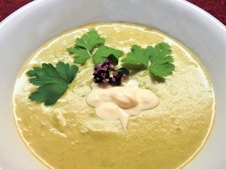 Creamy soup made of potatoes, leek and processed cheese