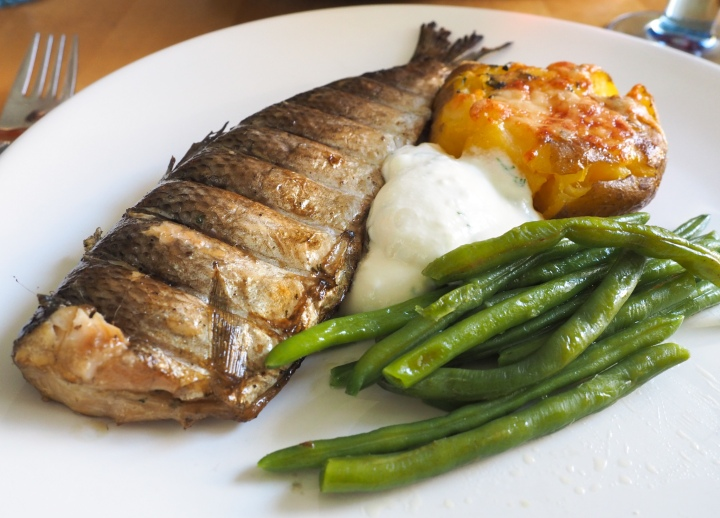 Broiled whole whitefish with flattened oven potatoes